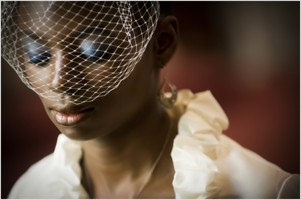 bride with blusher veil in church