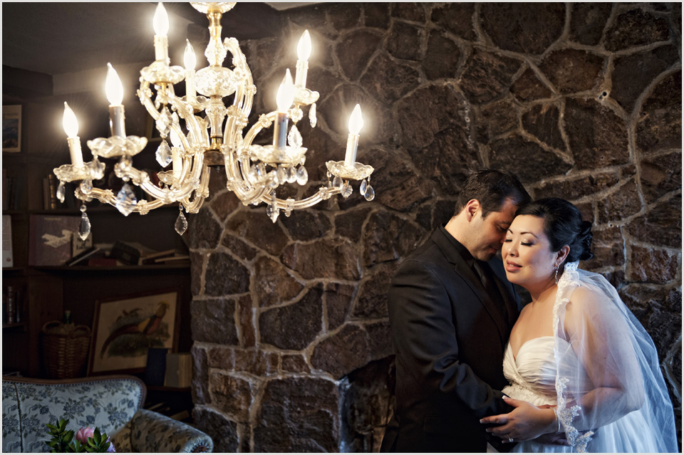 wedding photo of a bride and groom with chandelier