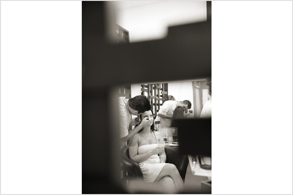 the bride gets her makeup done in the salon at Azul Sensatori