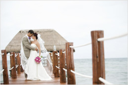a romantic moment with the bride and groom after their beach wedding