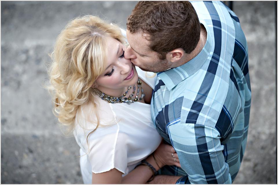 guy kisses girls cheek